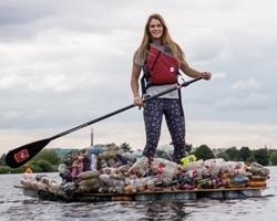 Paddle Boarder Trash Cleanup