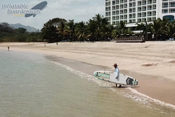 Carrying THURSO iSUP on Beach