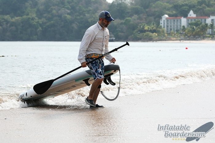 Pulling iSUP on Beach