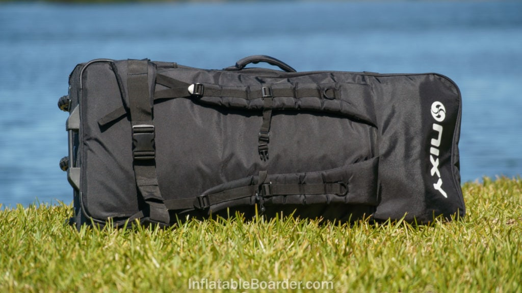 The back of the black NIXY backpack, showing padded shoulder and waist straps.