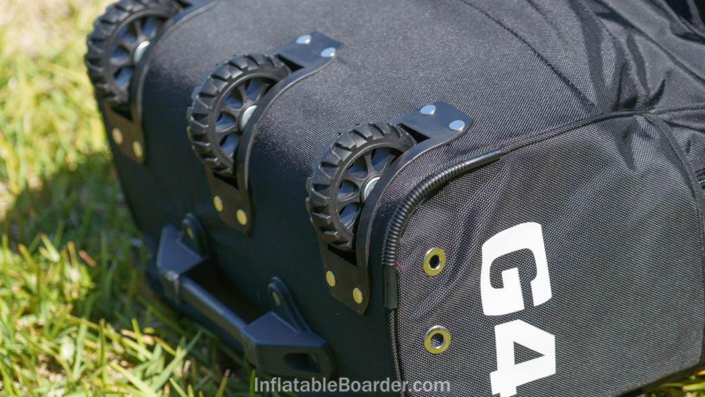 The bottom of the G4 backpack has three heavy duty wheels and a hard handle.