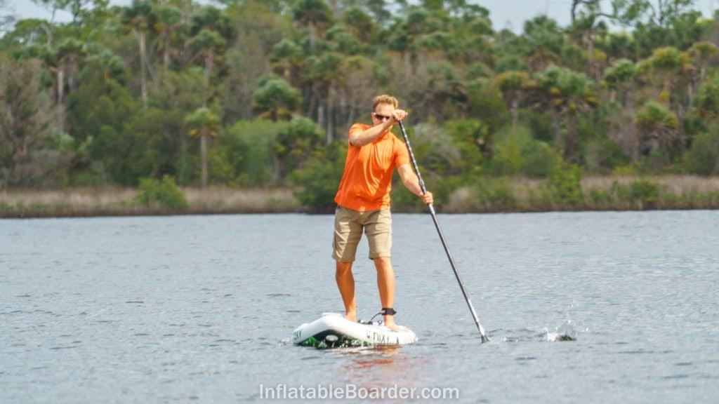 Nixy Newport paddling hard on ocean