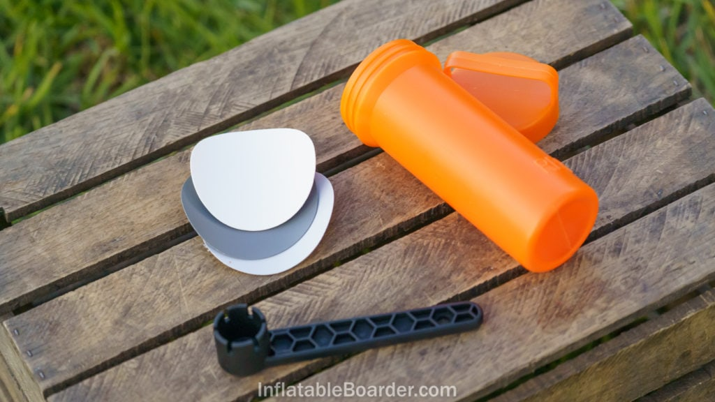The NIXY repair kit includes three vinyl patches, a valve wrench, and an orange container.