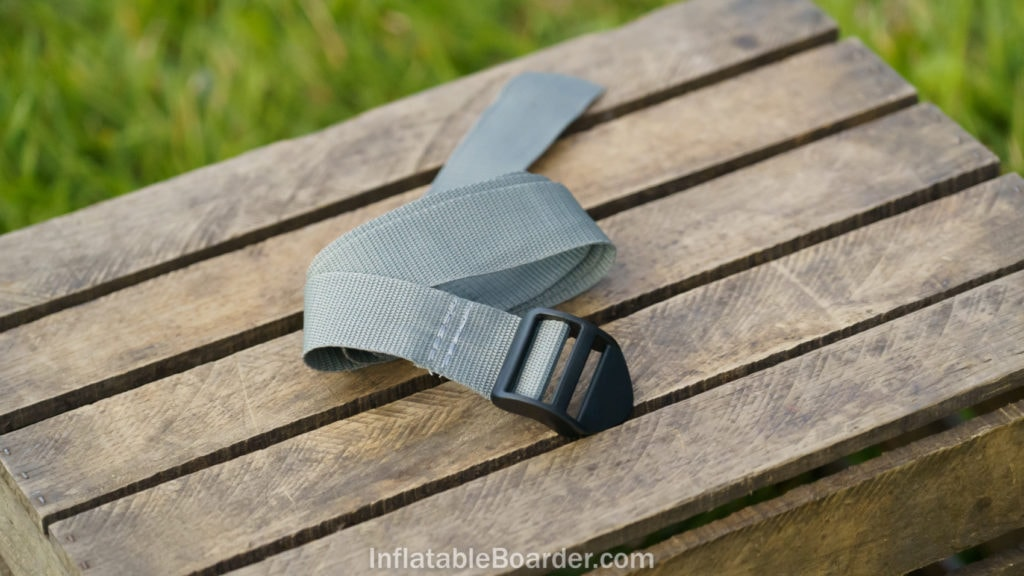 The included SUP compression strap is made of woven gray nylon.