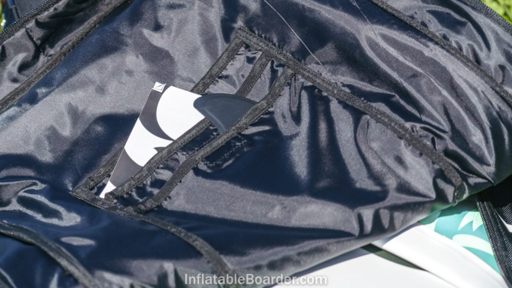 The inside of the bag is lined and includes three small velcro pockets.