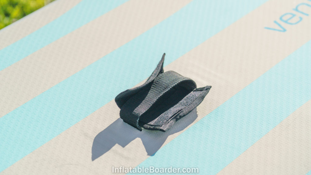 The center handle of the board has a removable neoprene cushion.