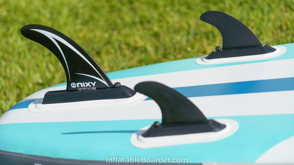 Large main fin and two smaller side fins at the back of the board.