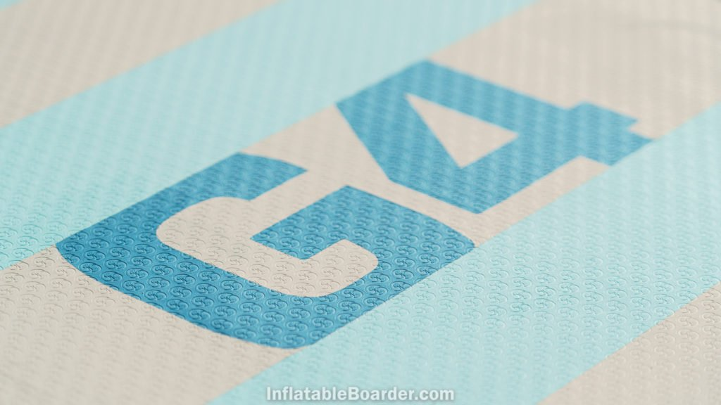 Detail of the broad, flat deck foam with the G4 brand and stamped NIXY logo for grip