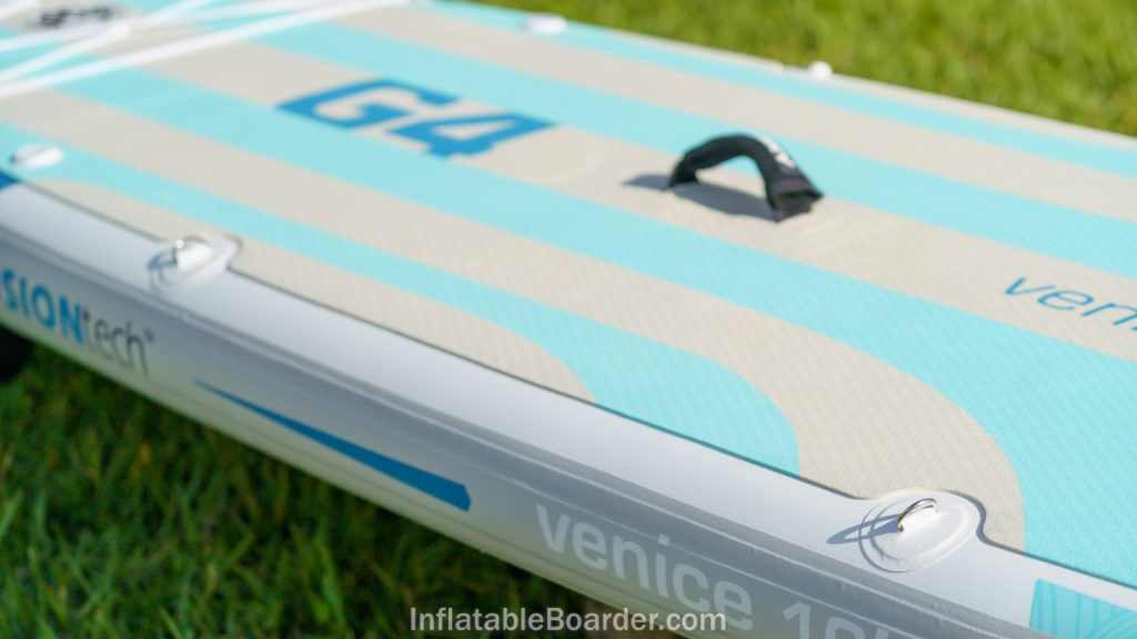 The side of the SUP features two sets of d-rings, a cushioned handle, and large foam pad.