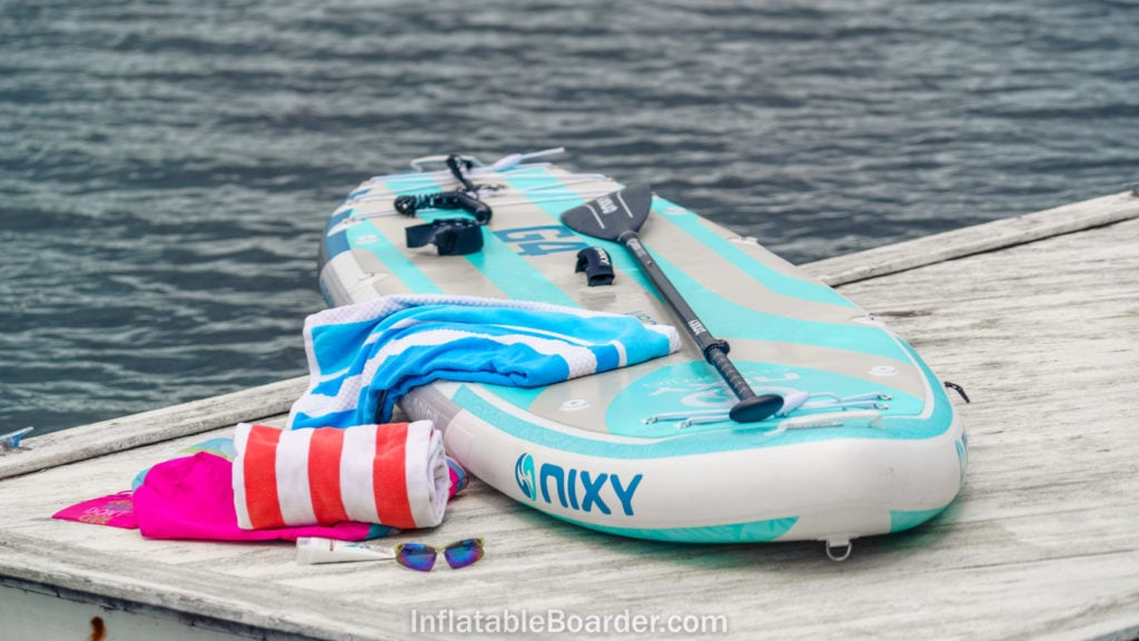 2021 NIXY Venice paddle board on a dock with towels.