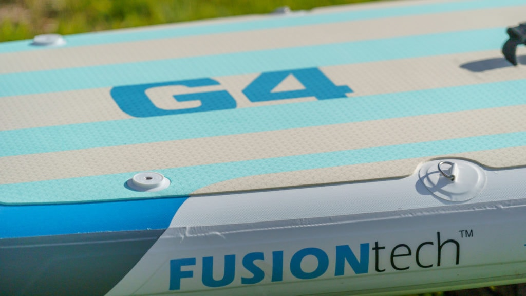 Side of the G4 board featuring FusionTech construction branding, action mounts, and d-rings.