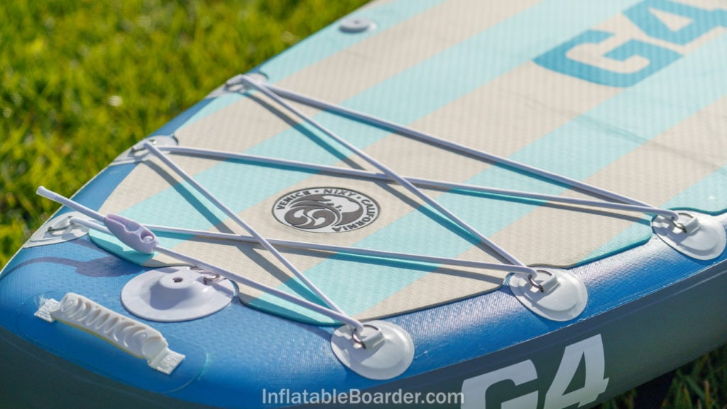 The back of the board features a handle and action mount with integrated SUP leash point.