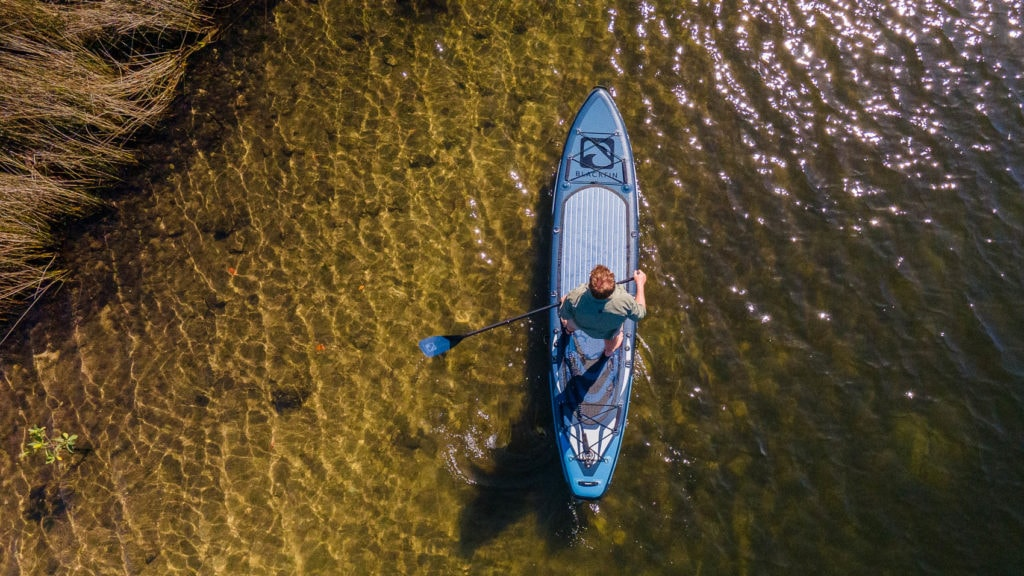 Top view of paddling the Model V on a river.