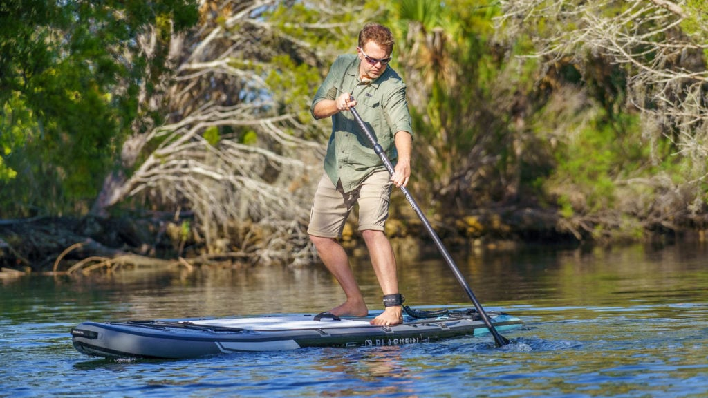 A man turning the XL hard on a river.