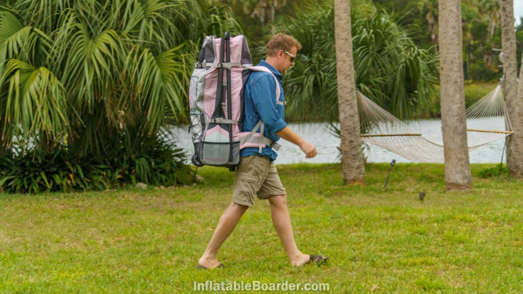 Carrying the All Around 10's bag on grass.
