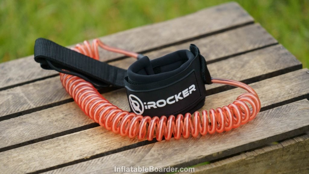 The coral-pink coiled SUP leash.