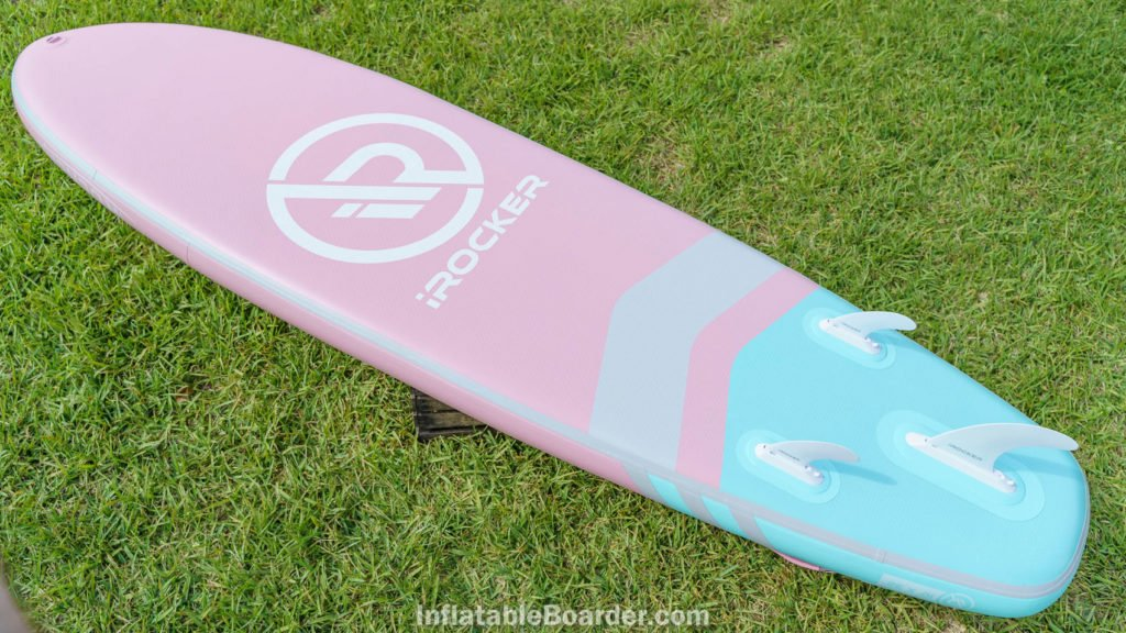 Bottom of the pink All-Around 10' with fins, front d-ring, and large iROCKER logo.