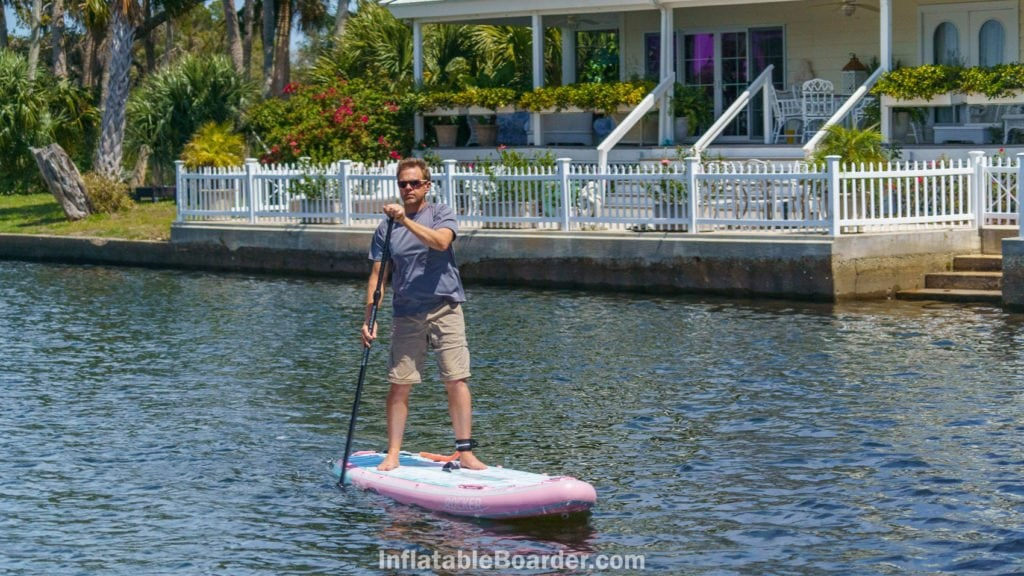 Paddling the board straight on to demonstrate tracking ability.