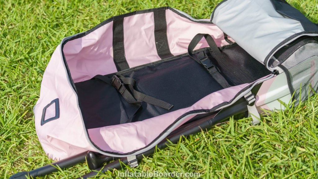 The inside of the bag is unlined and includes two tie-down straps.
