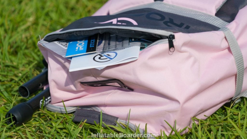 A small zipper pocket can be found at the very top of the back of the bag.