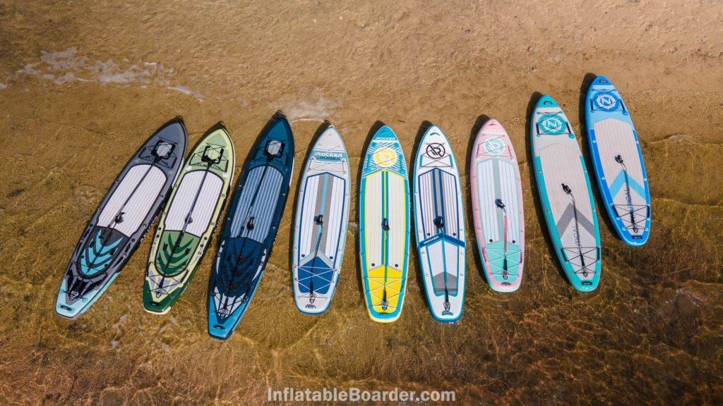 2021 iROCKER, NAUTICAL, and BLACKFIN range of boards on a beach..