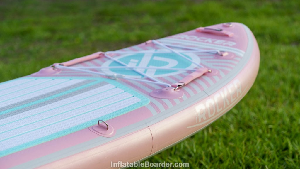 Nose of the pink board with iROCKER logos, handle, cargo area, action mounts, and d-ring.