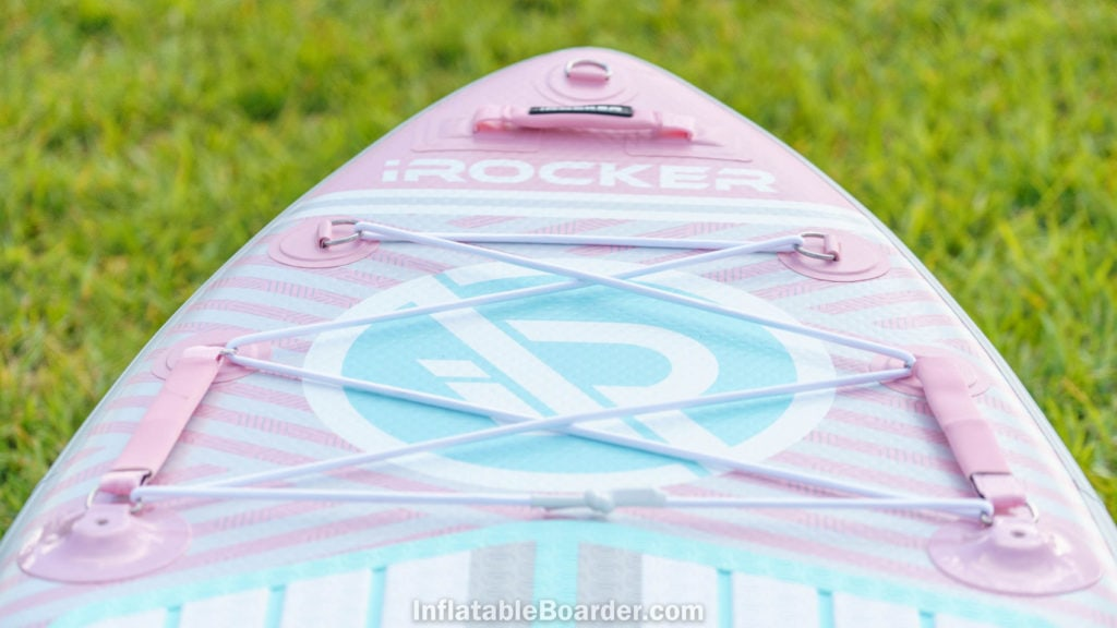 Detail of the front of the pink board with nose d-ring, padded handle, large bungie cargo area, and child handles.