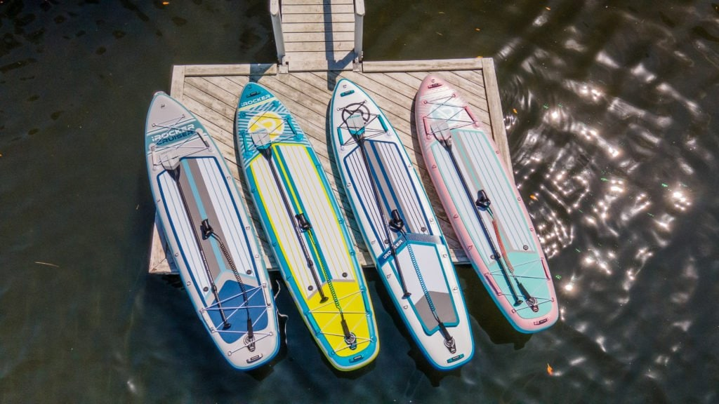 2021 iROCKER paddle boards on a dock. Left to right: Cruiser, All-Around 11', Sport, and All-Around 10'.