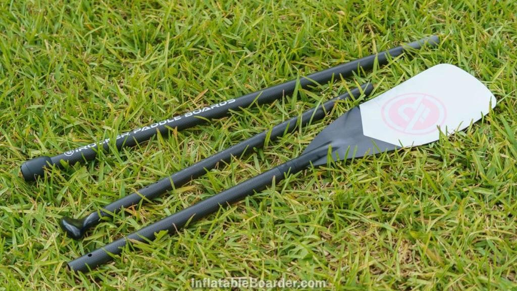 The three-piece pink iROCKER paddle on grass.