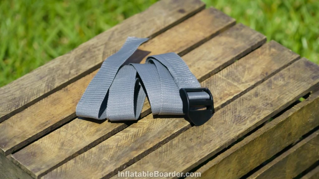 A gray nylon compression strap is included for the SUP.