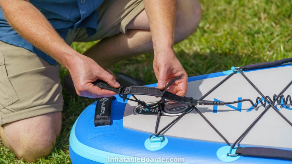 Attaching the SUP leash to the rear d-ring.