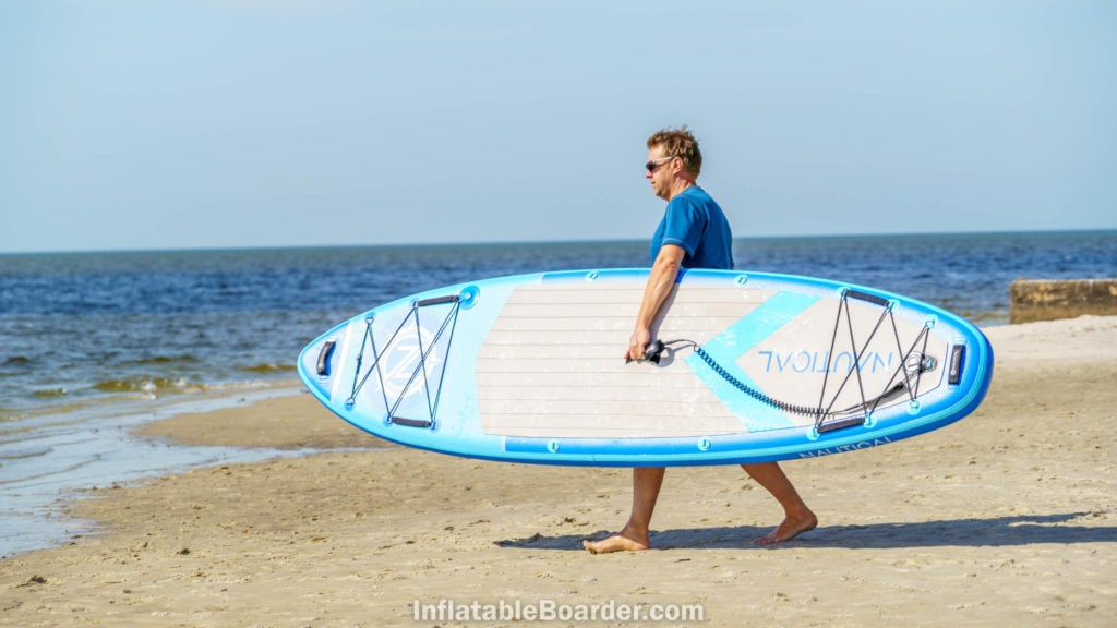 """Carrying the 10'6"""" from beach to ocean."""