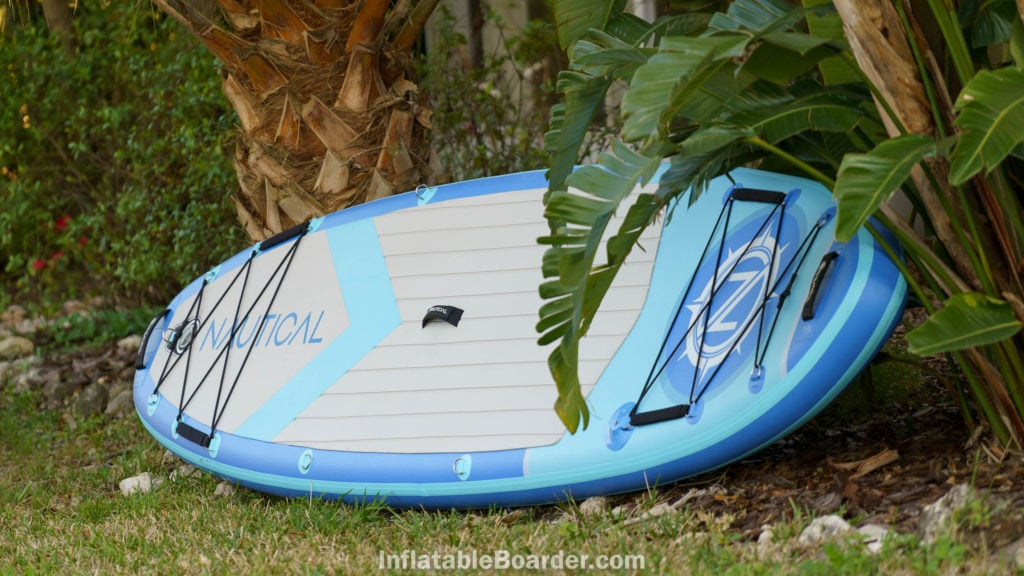 """The 10'6"""" board laying on grass."""