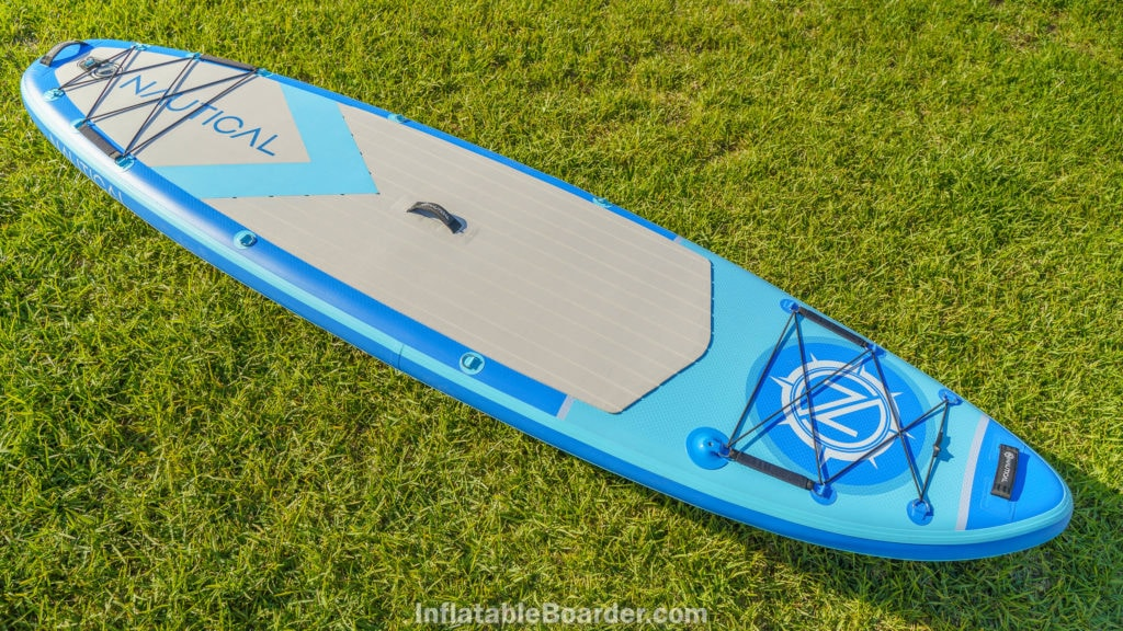 """2021NAUTICAL 10'6"""" paddle board top overview, featuring two large bungie cargo areas, three handles, front and rear child handles, 1 action mount, 4 center d-rings, and deeply grooved deck texture."""