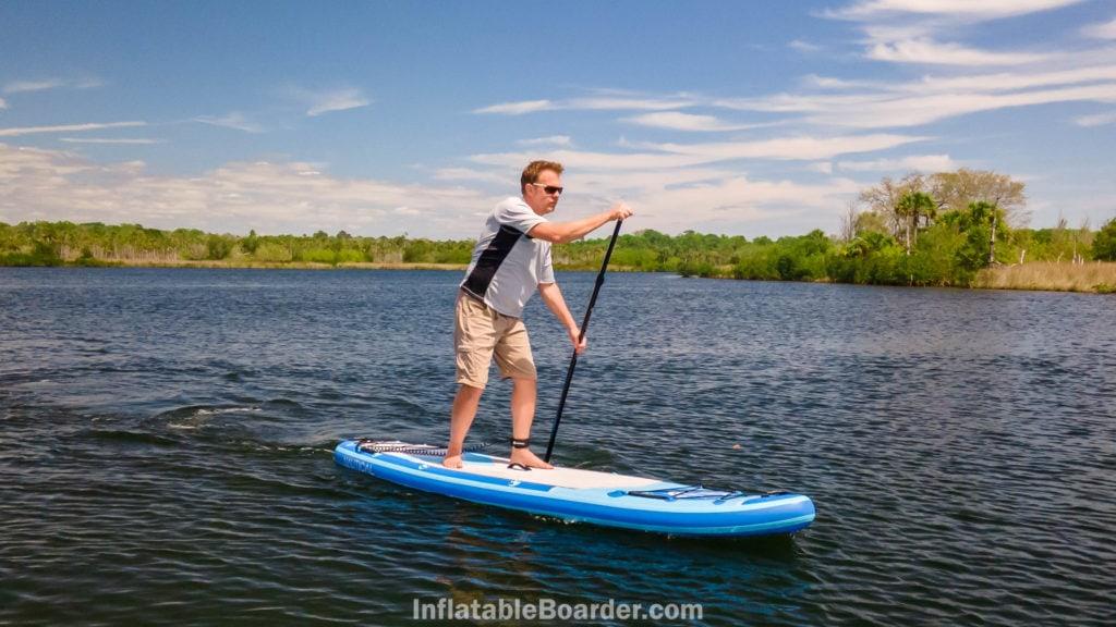 Paddling fast on a lake.