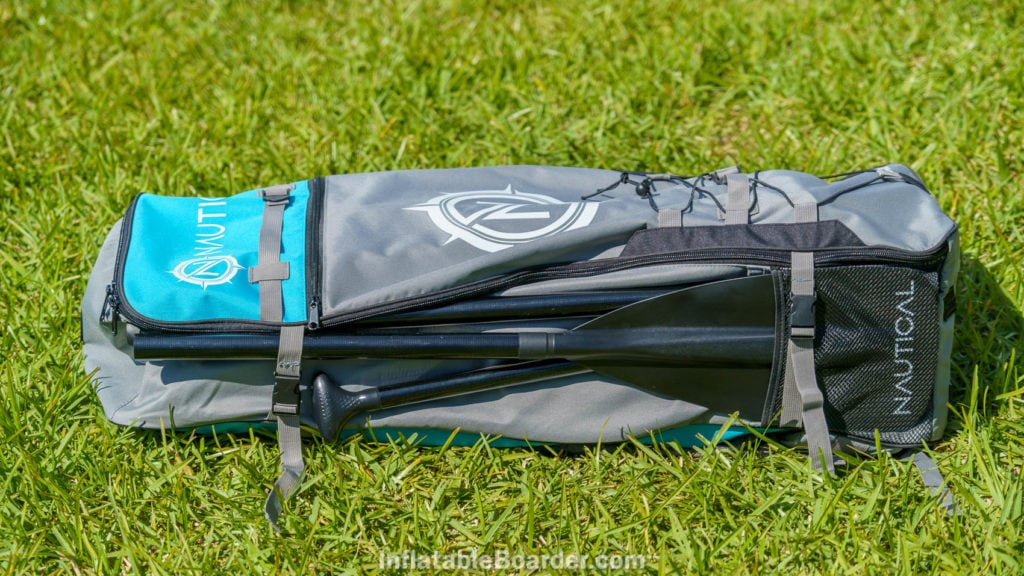 The side of the bag includes a paddle holder, though the top strap is too high up to hold the handle.