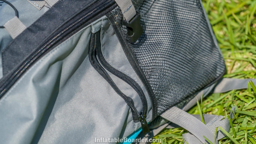 The bag has a small zippered pocket by each side paddle holder.