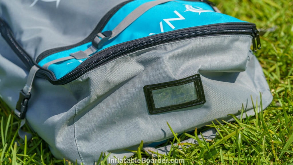 The top of the bag has a clear luggage tag window.
