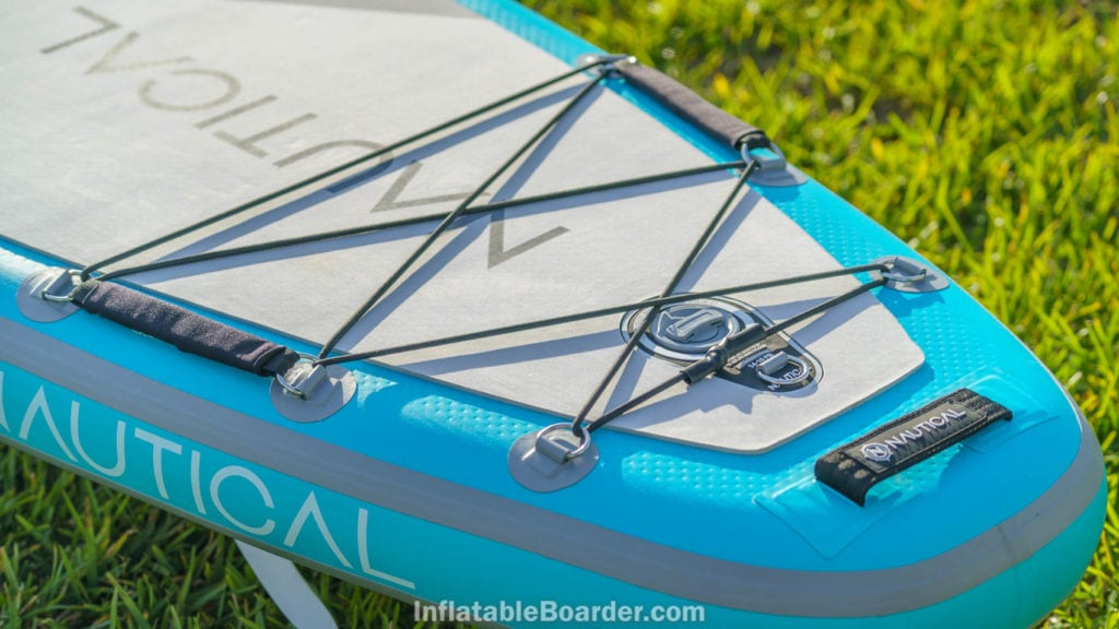 Detail of the rear of the board with large bungie cargo area, detachable child handles, inflation valve, leash attachment, and handle.