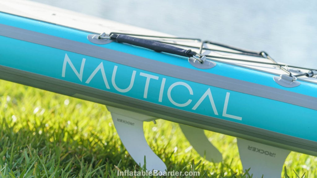 Side of the board with the NAUTICAL logo and child handle strap.