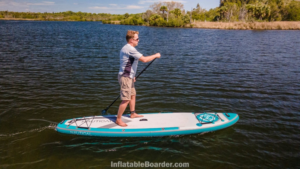 Side view of paddling the board.