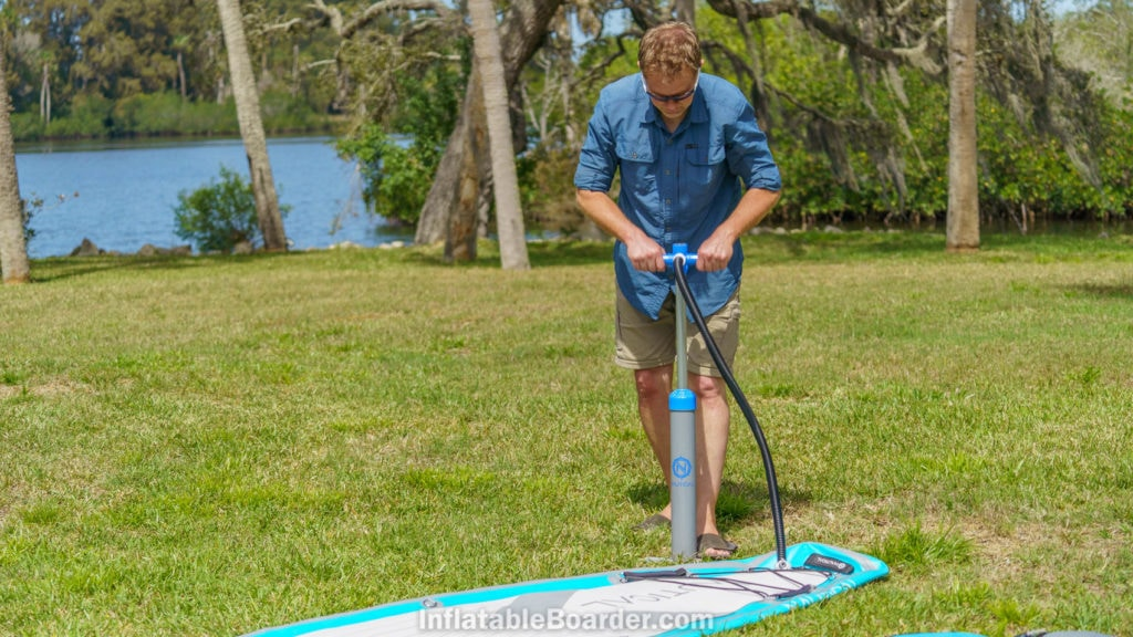 Inflating the SUP with the single chamber dual-stage pump.
