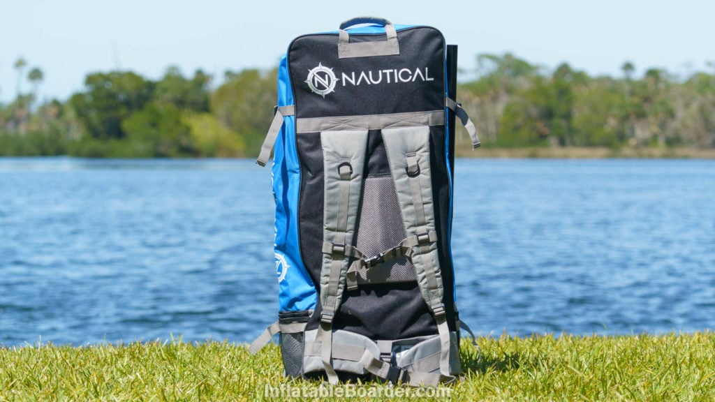 Overview of the back of the bag, showing straps and top handle.
