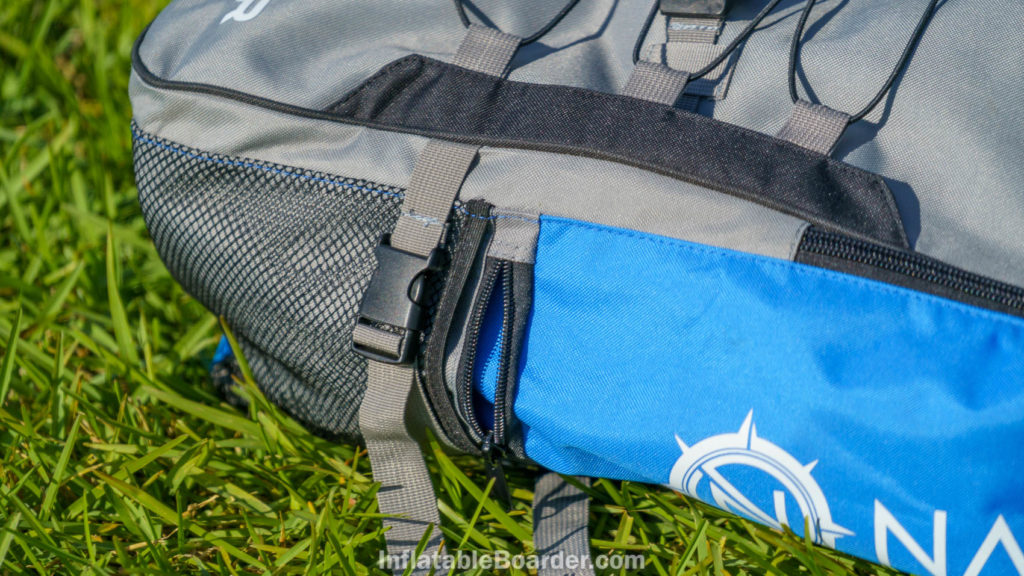 The sides of the bag have mesh paddle pockets and zippered pouches.