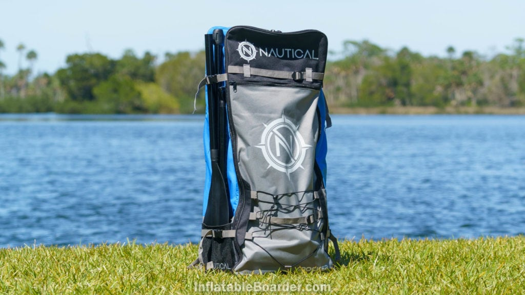 Overview of the front of the bag with compression straps, paddle holder, and bungie cargo area.