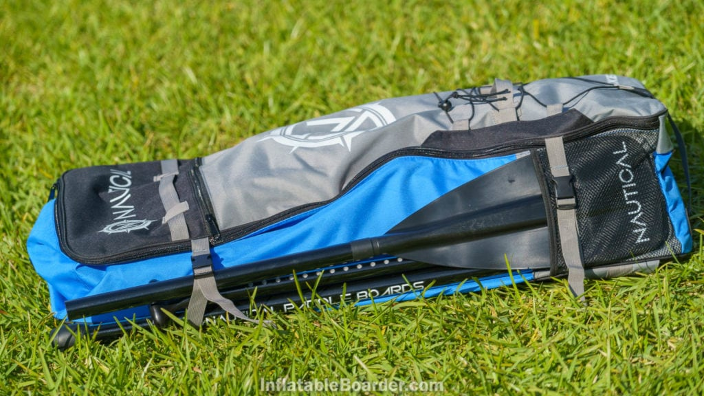 Side of the bag with paddle holder and compression straps.
