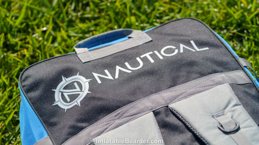 Top-back of the bag with NAUTICAL logo and padded handle.