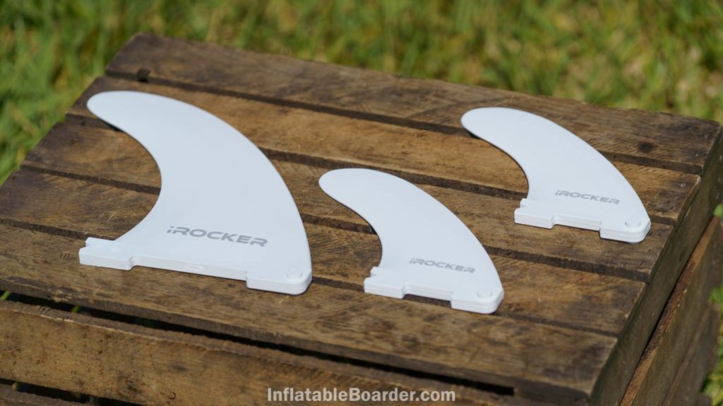 """The three quick-attach fins are white and read """"iROCKER"""". The main fin is larger than the side fins."""