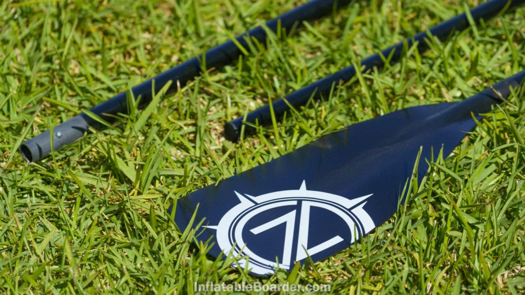 The paddle blade is black nylon with the Nautical logo.