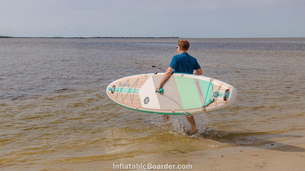 Carrying the Waterwalker 120 into the ocean.